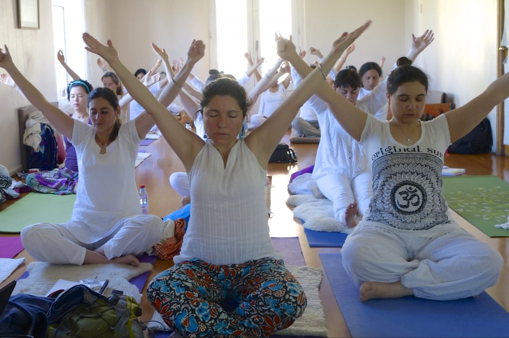 women practicing breath of fire in a yogic posture